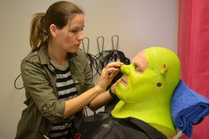 "Bernadette Schett applying our make-up for ""Shrek - the musical"""